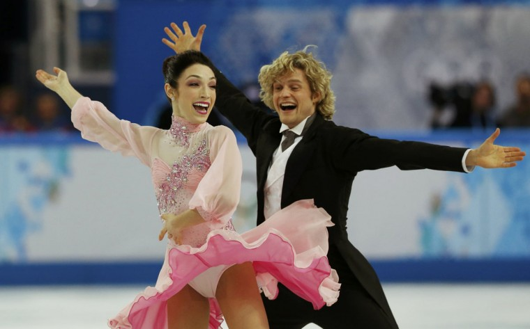 Meryl Davis and Charlie White of the U.S. compete during the figure skating ice dance short dance program at the Sochi 2014 Winter Olympics, February 16 2014. (Alexander Demianchuk/Reuters)