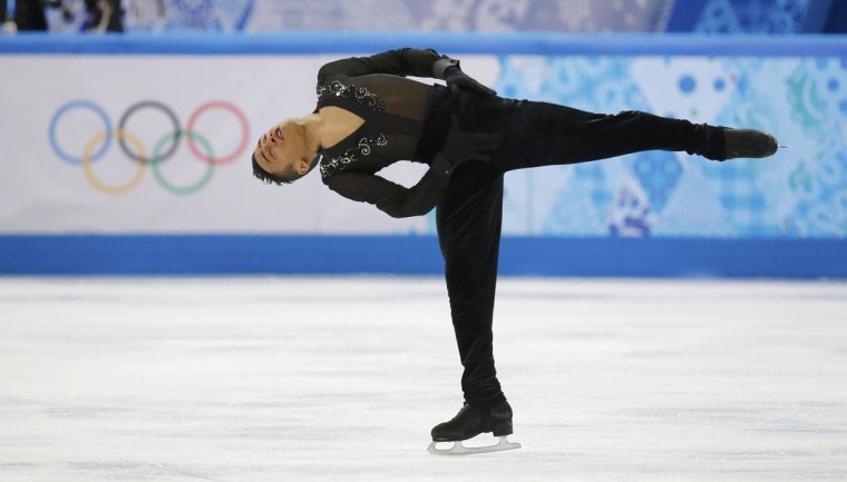 France's Florent Amodio competes during the figure skating team men's short program at the Sochi 2014 Winter Olympics. (REUTERS/Alexander Demianchuk)
