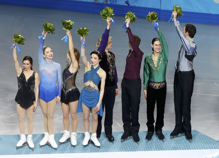The U.S. figure skating team celebrates its bronze medal on the podium at the Sochi 2014 Winter Olympics, February 9, 2014. From left to right: Marissa Castelli, Gracie Gold, Ashley Wagner, Meryl Davis, Charlie White, Jeremy Abbott, Jason Brown, Simon Shnapir. (Brian Snyder/Reuters)