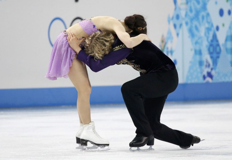 Meryl Davis and Charlie White of the U.S. react after their figure skating ice dance free dance program at the Sochi 2014 Winter Olympics, February 17, 2014. (Lucy Nicholson/Reuters)