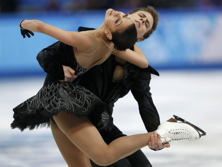Elena Ilinykh (left) and Nikita Katsalapov of Russia compete during the figure skating team ice dance free dance at the Sochi 2014 Winter Olympics, February 9, 2014. (Alexander Demianchuk/Reuters)