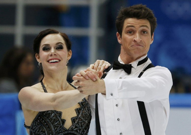 Canada's Tessa Virtue and Scott Moir compete during the figure skating ice dance short dance program at the Sochi 2014 Winter Olympics, February 16 2014. (Alexander Demianchuk/Reuters)
