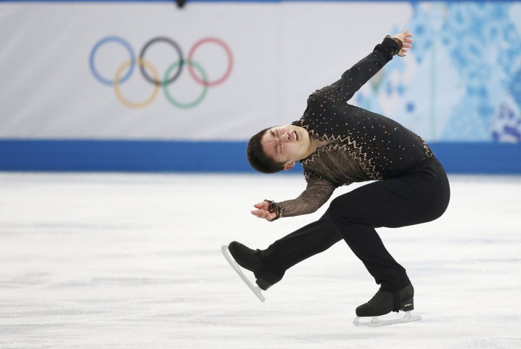 China's Yan Han competes during the figure skating team men's short program at the Sochi 2014 Winter Olympics. (REUTERS/Lucy Nicholson)