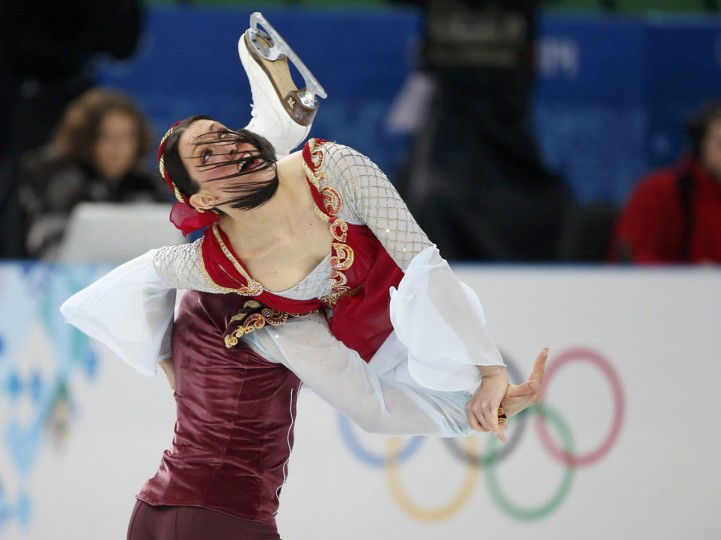 Italy's Charlene Guignard (right) and Marco Fabbri compete during the figure skating ice dance free dance program at the Sochi 2014 Winter Olympics, February 17, 2014. (Lucy Nicholson/Reuters)