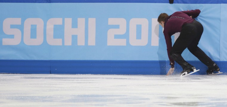 Jeremy Abbott of the U.S. continues after falling during the figure skating team men's short program at the Sochi 2014 Winter Olympics. (REUTERS/Alexander Demianchuk)