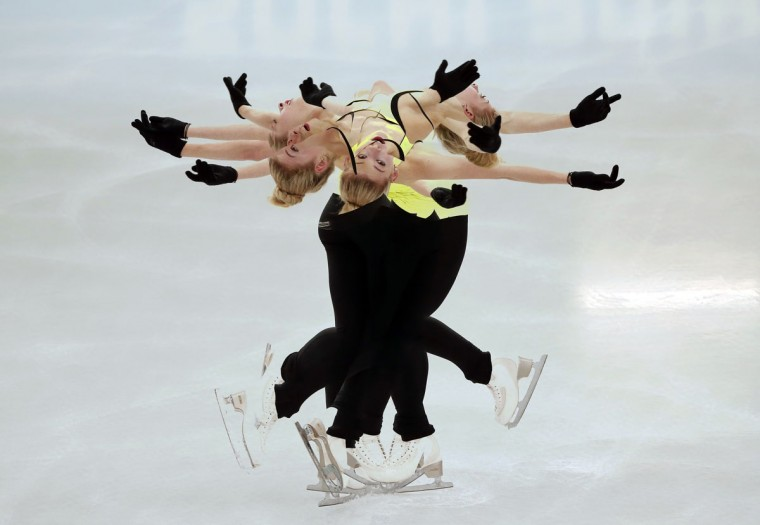 Gracie Gold of the U.S. practices her routine during a figure skating training session at the Iceberg Skating Palace training arena during the 2014 Sochi Winter Olympics February 17, 2014. Picture taken with multiple exposure. (Lucy Nicholson/Reuters)