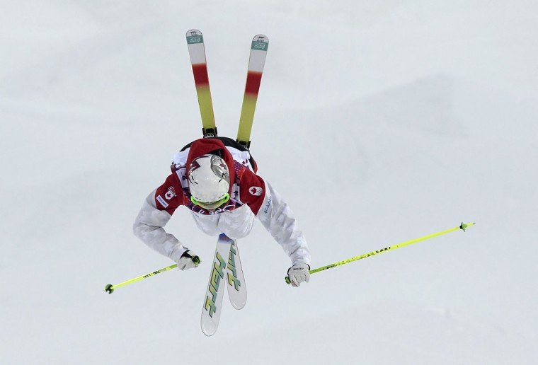 Canada's Maxime Dufour-Lapointe performs a jump during the women's freestyle skiing moguls qualification round at the 2014 Sochi Olympic Games in Rosa Khutor. (REUTERS/Dylan Martinez)