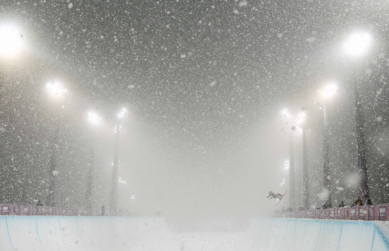 A skier competes during the men's freestyle skiing halfpipe finals at the Sochi 2014 Winter Olympics in Rosa Khutor February 18, 2014. REUTERS/Mike Segar
