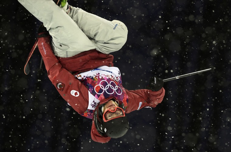 Canada's Mike Riddle performs a jump during the men's freestyle skiing halfpipe qualification round at the 2014 Sochi Winter Olympic Games in Rosa Khutor February 18, 2014. REUTERS/Dylan Martinez