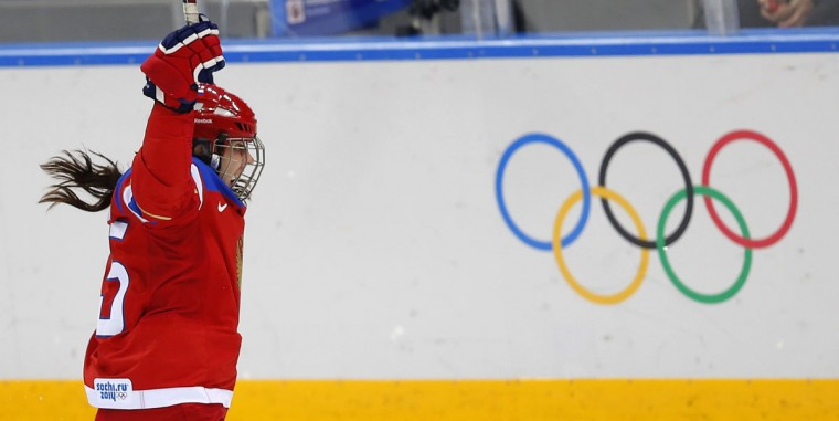 Russia's Galina Skiba celebrates scoring against Japan during the second period of their women's classification ice hockey game at the Sochi 2014 Winter Olympic Games February 16, 2014. (Laszlo Balogh/Reuters)