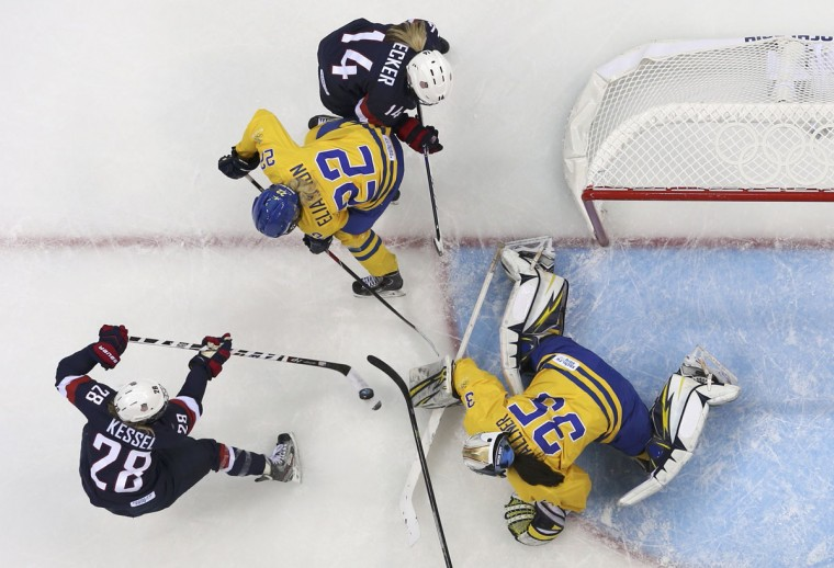 Team USA's Amanda Kessel (left) shoots past Sweden's goalie Valentina Wallner (35) to score during the first period of their women's semi-final ice hockey game at the Sochi 2014 Winter Olympic Games, February 17, 2014. (Laszlo Balogh/Reuters)