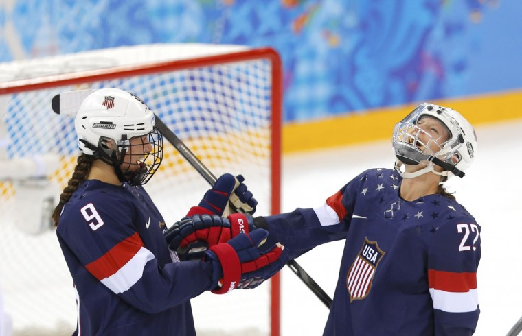 Team USA's Megan Bozek (left) and Kacey Bellamy celebrate after defeating Sweden in their women's semi-final ice hockey game at the 2014 Sochi Winter Olympic Games, February 17, 2014. (Laszlo Balogh/Reuters)