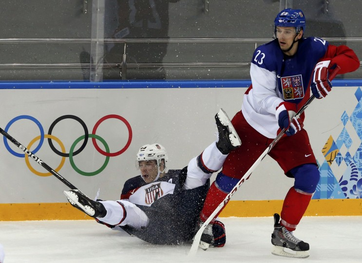 Czech Republic's Zbynek Michalek (R) checks Team USA's Dustin Brown into the boards during the second period of their men's quarter-finals ice hockey game at the 2014 Sochi Winter Olympic Games February 19, 2014. (REUTERS/Grigory Dukor)