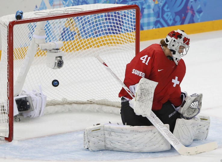 Switzerland's goalie Florence Schelling lets in Canada's second goal scored by Natalie Spooner (not seen) during the first period of their women's ice hockey semi-final game at the Sochi 2014 Winter Olympic Games February 17, 2014. (Jim Young/Reuters)