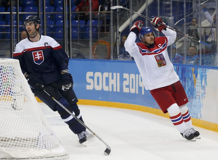 The Czech Republic's Tomas Plekanec (R) celebrates his goal next to Slovakia's Zdeno Chara during the third period of their men's qualification round ice hockey game at the 2014 Sochi Sochi Winter Olympics, February 18, 2014. REUTERS/Jim Young