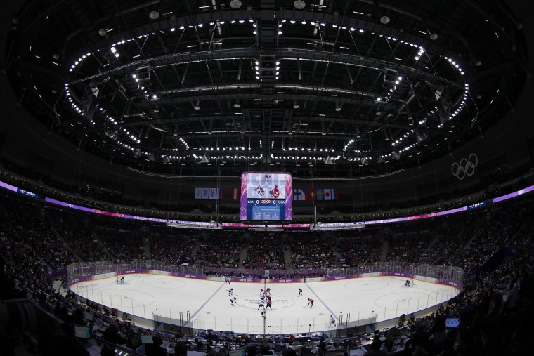 A general view of the opening face off at the women's ice hockey gold medal game between Team USA and Canada at the Sochi 2014 Winter Olympics February 20, 2014. (REUTERS/Jim Young)
