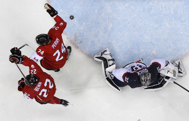 Canada's Jamie Benn (22) celebrates his goal next to teammate Corey Perry after scoring past Team USA's goalie Jonathan Quick (R) during the second period of their men's ice hockey semi-final game at the Sochi 2014 Winter Olympic Games February 21, 2014. (REUTERS/Mark Blinch)