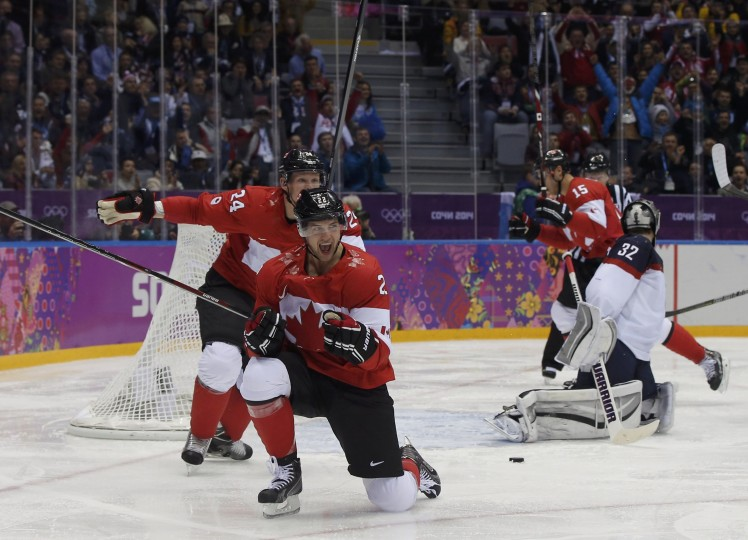 Canada's Jamie Benn (C) celebrates his goal against Team USA's goalie Jonathan Quick (R) during the second period of the men's ice hockey semi-final game at the 2014 Sochi Winter Olympic Games, February 21, 2014. (REUTERS/Phil Noble)