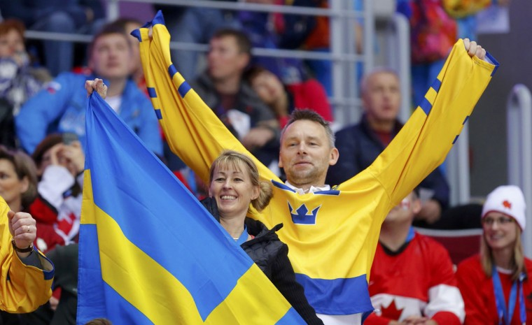 Swedish fans cheer ahead of the men's ice hockey gold medal game against Canada at the 2014 Sochi Winter Olympic Games. (REUTERS/Laszlo Balogh)