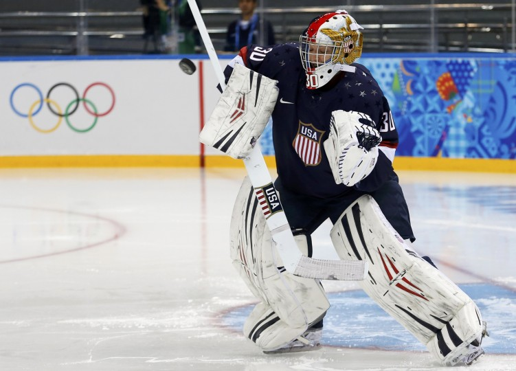 Team USA's goalie Molly Schaus makes a save against Switzerland during the second period of their women's preliminary round hockey game at the Sochi 2014 Winter Olympic Games, February 10, 2014. (Mark Blinch/Reuters)