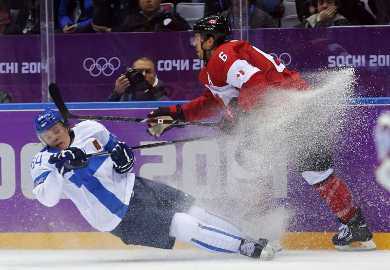 Canada's Shea Weber (right) knocks down Finland's Mikael Granlund during the third period of their men's preliminary round ice hockey game at the Sochi 2014 Winter Olympic Games February 16, 2014. (Mark Blinch/Reuters)