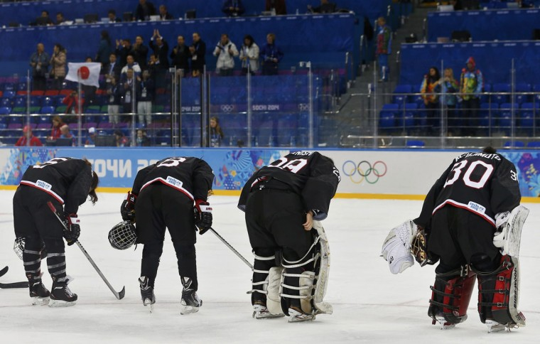 Japan's Kanae Aoki (from left), Tomoe Yamane, goalie Akane Konishi and goalie Nana Fujimoto (R) bow after losing their women's preliminary round hockey game to Sweden, at the Sochi 2014 Winter Olympic Games, February 9, 2014. (Jim Young/Reuters)