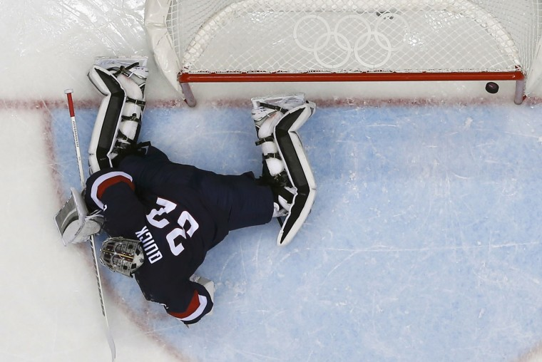 Team USA's goalie Jonathan Quick lets in a goal by Finland's Teemu Selanne during the first period of their men's ice hockey bronze medal game at the Sochi 2014 Winter Olympic Games February 22, 2014. (REUTERS/Mark Blinch)