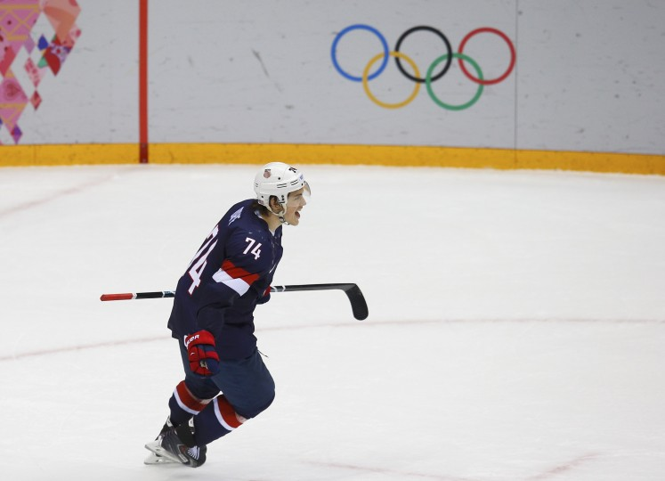 Team USA's T.J. Oshie celebrates after scoring the winning goal against Russia during a shootout in their men's preliminary round ice hockey game at the Sochi 2014 Winter Olympic Games February 15, 2014. REUTERS/Brian Snyder