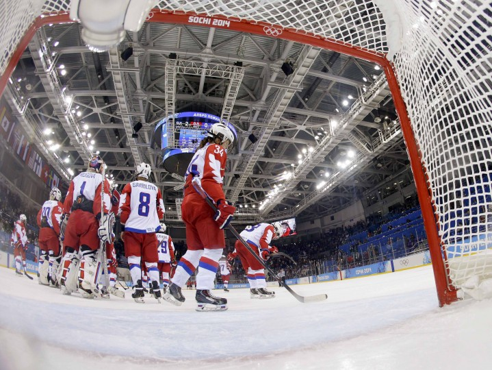 Russian players react after their loss to Switzerland in their women's ice hockey quarter-final play-off game at the 2014 Sochi Winter Olympics February 15, 2014. REUTERS/Shamil Zhumatov
