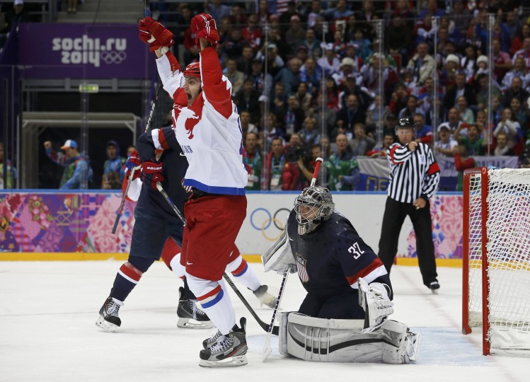 Russia's Alexander Radulov (L) celebrates a goal by teammate Pavel Datsyuk (not pictured) against Team USA's goalie Jonathan Quick, during the third period of their men's preliminary round ice hockey game at the Sochi 2014 Winter Olympic Games February 15, 2014. REUTERS/Jim Young