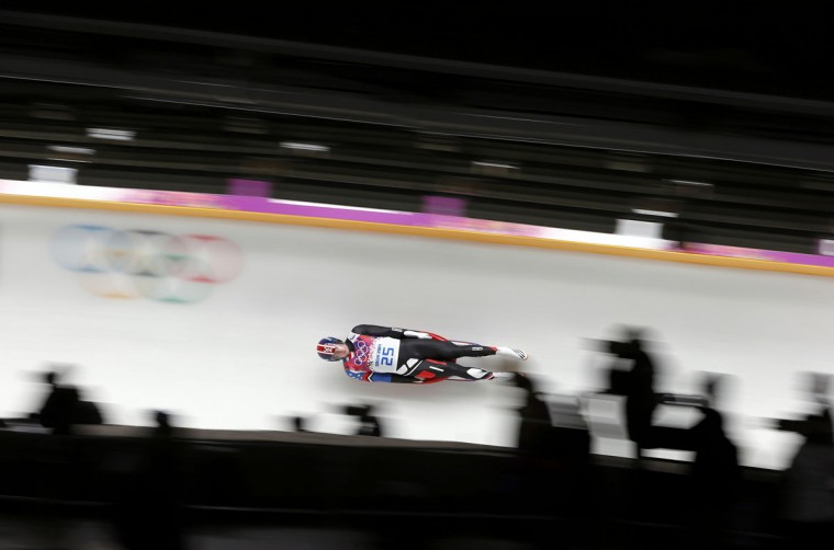 Tucker West of the U.S. speeds down the track in the men's singles luge competition at the 2014 Sochi Winter Olympics February 9, 2014. (Arnd Wiegmann/Reuters)