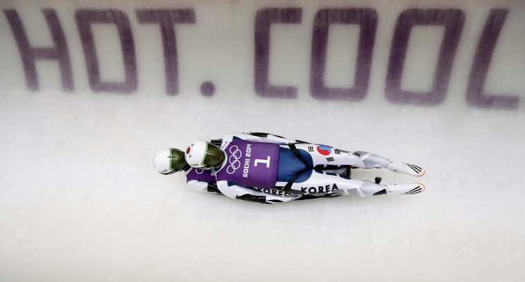 South Korea's Jinyong Park and Jung Myung Cho speed down the track during a men's doubles luge training session at the 2014 Sochi Winter Olympics in the Sanki Sliding Center, Rosa Khutor near Sochi, February 10, 2014. (Murad Sezer/Reuters)