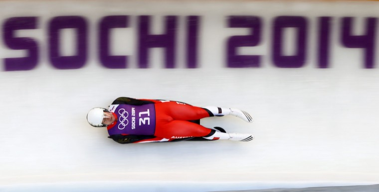 Austria's Daniel Pfister speeds down the track during a men's luge training at the Sanki sliding center in Rosa Khutor, a venue for the Sochi 2014 Winter Olympics near Sochi. (REUTERS/Arnd Wiegmann)