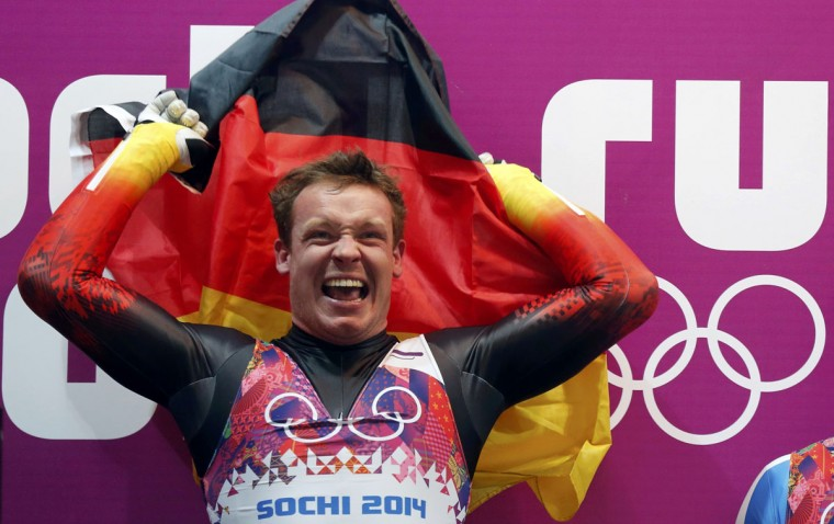 Germany's Felix Loch celebrates after winning the men's singles luge competition at the 2014 Sochi Winter Olympics February 9, 2014. (Murad Sezer/Reuters)