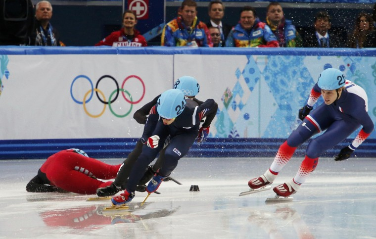 China's Shi Jingnan (left) crashes during the men's 1,500-meter short track speedskating heats event at the Iceberg Skating Palace during the 2014 Sochi Winter Olympics February 10, 2014. (David Gray/Reuters)