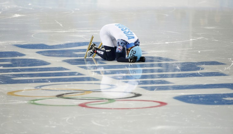 Victor An of Russia reacts on the ice as he wins the men's 1,000 metres short track speed skating final event at the Iceberg Skating Palace during the Sochi 2014 Winter Olympics February 15, 2014. REUTERS/Lucy Nicholson
