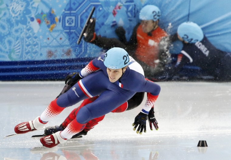 South Korea's Park Se-Yeong (back right) falls and takes out Sjinkie Knegt of the Netherlands, as France's Sebastien Lepape (front) and Canada's Francois Hamelin (hidden) skate past during the men's 1,500-meter short track speedskating finals at the 2014 Sochi Winter Olympics. (Lucy Nicholson/Reuters)