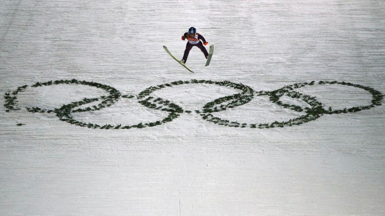 Maciej Kot of Poland soars through the air during his jump in the men's ski jumping individual normal hill qualification round event at the Sochi 2014 Winter Olympic Games February 8, 2014. (REUTERS/Michael Dalder)