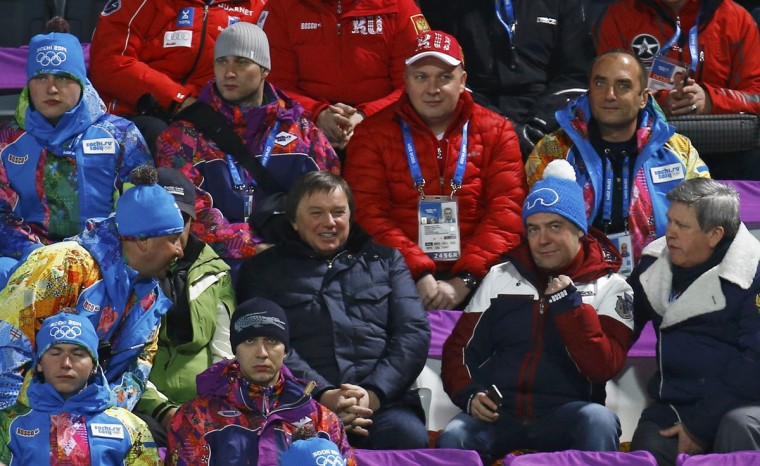 Russian Prime Minister Dmitry Medvedev reacts as he attends the men's ski jumping normal hill individual final event of the Sochi 2014 Winter Olympic Games, at the RusSki Gorki Ski Jumping Center in Rosa Khutor, February 9, 2014. (Kai Pfaffenbach/Reuters)