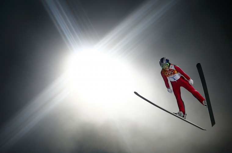 Sarah Hendrickson of the U.S. soars through the air in her trial jump during the women's ski jumping individual normal hill event of the Sochi 2014 Winter Olympics, at the RusSki Gorki Ski Jumping Center in Rosa Khutor February 11, 2014. (REUTERS/Kai Pfaffenbach)