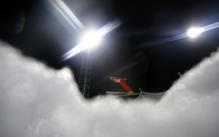 Poland's Kamil Stoch soars through the air in his trial jump during a qualifying session for the men's ski jumping large hill individual event during the Sochi 2014 Winter Olympic Games, at the RusSki Gorki Ski Jumping Center in Rosa Khutor, February 14, 2014. REUTERS/Kai Pfaffenbach