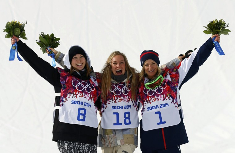 Winner Jamie Anderson of the U.S. (C), silver medalist Finland's Enni Rukajarvi and third-place finisher Britain's Jenny Jones pose on the podium at the victory ceremony after the women's snowboard slopestyle competition at the 2014 Sochi Olympic Games, February 9, 2014. (Mike Blake/Reuters)