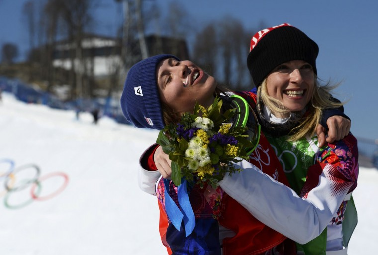 Gold medal winner Eva Samkova of the Czech Republic (left) and Canada's Dominique Maltais embrace after their women's snowboard cross finals at the Sochi 2014 Winter Olympics in Rosa Khutor, February 16, 2014. (Dylan Martinez/Reuters)