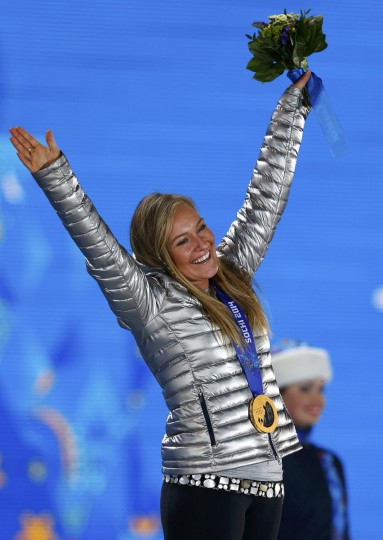 Gold medalist Jamie Anderson of the U.S. poses on the podium at the medal ceremony after the women's snowboard slopestyle event at the 2014 Sochi Winter Olympics, February 9, 2014. (Shamil Zhumatov/Reuters)