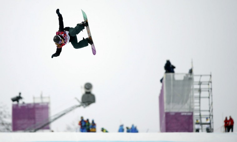 Switzerland's Isabel Derungs performs a jump during the women's snowboard slopestyle finals at the 2014 Sochi Winter Olympics in Rosa Khutor, February 9, 2014. (Mike Blake/Reuters)