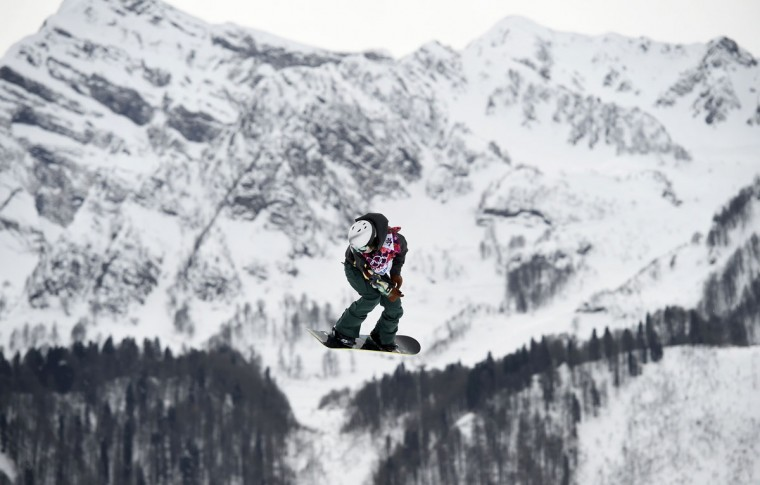Sarka Pancochova of the Czech Republic performs a jump during the women's snowboard slopestyle finals event at the 2014 Sochi Winter Olympics in Rosa Khutor, February 9, 2014. (Dylan Martinez/Reuters)