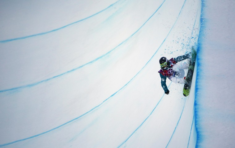 Australia's Torah Bright competes during the women's snowboard halfpipe qualification round at the Sochi 2014 Winter Olympics in Rosa Khutor February 12, 2014. REUTERS/Carlos Barria