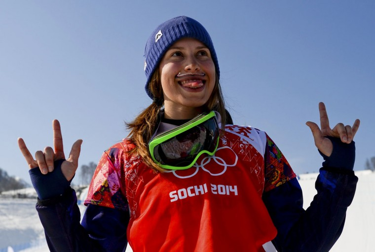 Eva Samkova of the Czech Republic celebrates winning a gold medal on podium after the women's snowboard cross finals at the 2014 Sochi Winter Olympic Games in Rosa Khutor, February 16, 2014. (Dylan Martinez/Reuters)