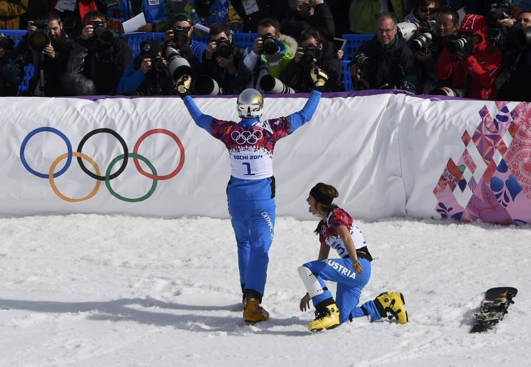 Austria's first placed Julia Dujmovits (R) and her third placed compatriot Benjamin Karl celebrate after the parallel snowboard finals at the 2014 Sochi Winter Olympic Games in Rosa Khutor February 22, 2014. (REUTERS/Dylan Martinez)