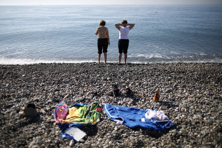 Volunteers enjoy the Black Sea near the Olympic Park during the Sochi 2014 Winter Olympics February 12, 2014. (REUTERS/Issei Kato)